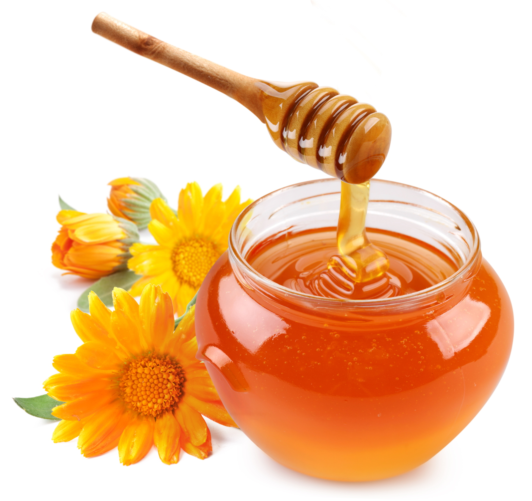 Honey pours with sticks in a jar.